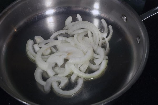 Add the sliced onions.