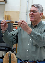 Photo: Here he shows the setup on the mandrel, and he starts by rounding the ends over.