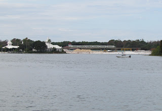 Photo: Work continues on the DVC expansion of the Grand Floridian. It's hard to see, but they're pushing new sand into the water so there's more land to build upon.