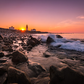 Lighthouse Sunrise by Matthew Robertson - Landscapes Waterscapes ( sky, waves, light house, pebbles, ocean, sunrise, morning, atlantic, rocks )