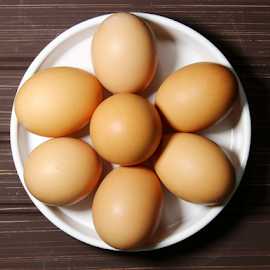 Brown eggs in a white plate by Dipali S - Food & Drink Cooking & Baking ( raw, shell, uncooked, cuisine, breakfast, egg, farm, chicken, nature, fresh, protein, cooking, carton, ingredient, meal, animal, row, nutrition, organic, easter, food, container, cardboard, tray, background, healthy, brown, eat, freshness, group, eggshell, produce )
