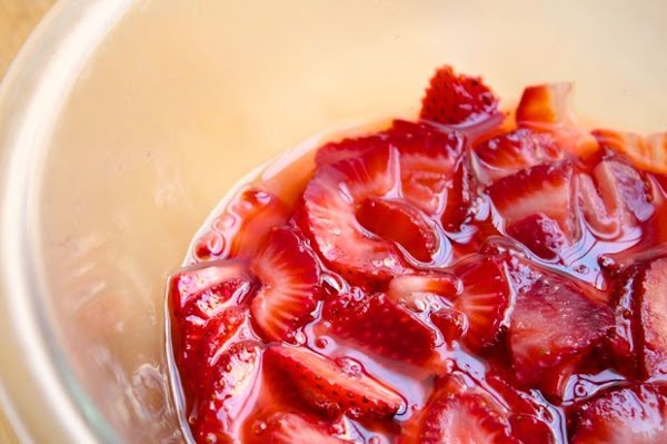 For the Strawberry mixture: Slice and core strawberries, place in a bowl, sprinkle 1/4...