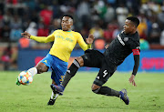 Mamelodi Sundowns forward Lebohang Maboe (L) is tackled by Orlando Pirates captain and defender Happy during a goalless Absa Premiership match at Orlando Stadium in Soweto on April 1 2019.
