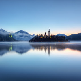 Feeling Blue by Conor MacNeill - Landscapes Mountains & Hills ( water, mountain, europe, church, still, lake, bled island, island, mountains, fog, blue, slovenia, bled, castle, julian alps, mist, lake bled, alps )