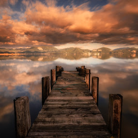 Firesky by Lunardi Fabrizio - Buildings & Architecture Bridges & Suspended Structures ( clouds, water, hills, warm light, colors, reflections, lake, landscape, shadows, contrast, mountains, red, sky, sunset, long exposure, golden hour )