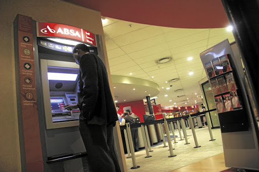 A man withdraws cash from an Absa ATM in Johannesburg. Picture: Gallo Images