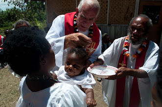 Photo: Rev. Ron Rall baptizing a baby in Papua New Guinea.