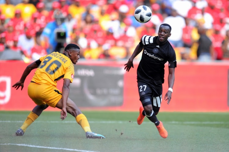 Siyabonga Ngezana of Kaizer Chiefs in action with Justin Shonga of Orlando Pirates during the Absa Premiership match between Orlando Pirates and Kaizer Chiefs at FNB Stadium on March 03, 2018 in Johannesburg.