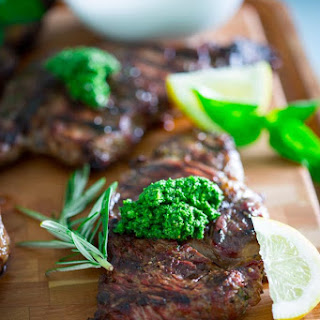 Garlic Rosemary Steaks With Kale Walnut Pesto.