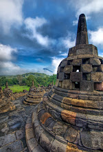 Photo: The buddhas in the belltowers  Across the wilds of Indonesia...