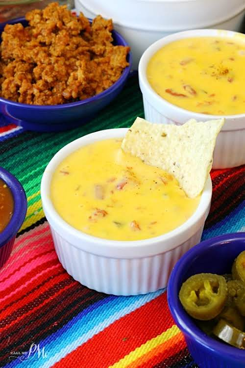 "Famous Queso Dip ""Famous Queso Dip Recipe that cheesy, gooey dip you..."