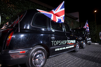 Photo: The Topshop black cabs arrive at the opening party.  Shop LA Style > http://bit.ly/XbGtM6