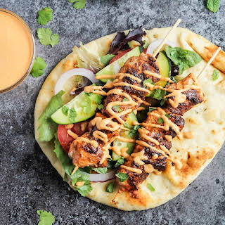 Grilled Chicken Naan Wraps with Roasted Red Pepper Tahini Sauce.