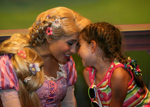 Photo: Little girl time with Rapunzel at the Meet the Princesses at Town Square Theater