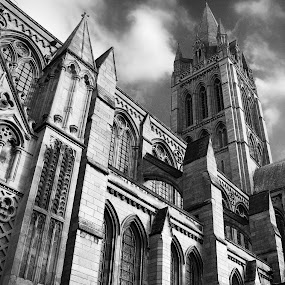 Truro cathedral by Aaron Nappin - Buildings & Architecture Architectural Detail ( clouds, building, black and white, low angle, cornish, truro, cornwall, religion, tower, window, cathedral, pillar, mono, wall )