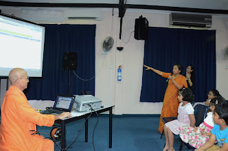 Photo: Ms Pushpa, Principal, explaining how to use ICHILD.