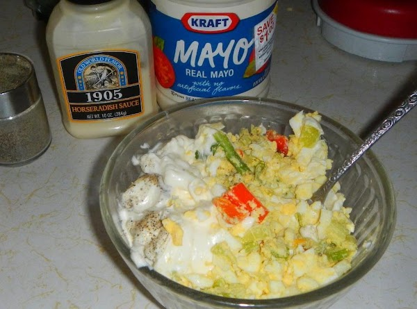 Put eggs, celery, onions and 1/2 cup chopped pecans in a bowl, and mix....gently.Mix...