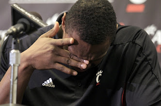 Photo: The University of Cincinnati's Yancy Gates wipes away tears as he talks after he apologizes during a news conference for his part in a brawl at the Crosstown Shootout against Xavier.  Photo by Cara Owsley, The Cincinnati Enquirer.