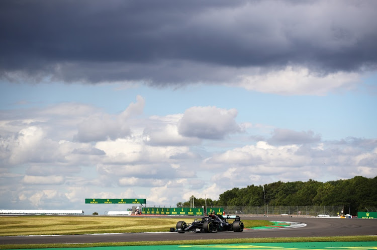 Lewis Hamilton of Great Britain driving the (44) Mercedes AMG Petronas F1 Team Mercedes W11 on track during qualifying for the F1 Grand Prix of Great Britain at Silverstone on August 01, 2020 in Northampton, England.