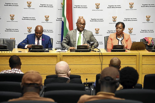 Cultural commissar: Arts and Culture Minister Nathi Mthethwa, centre, at a media briefing in Parliament in March. He is flanked by director-general Vusi Mkhize, left, and arts and culture institutional governance deputy director-general Kelebogile Sethibelo. Picture: SIYABULELA DUDA