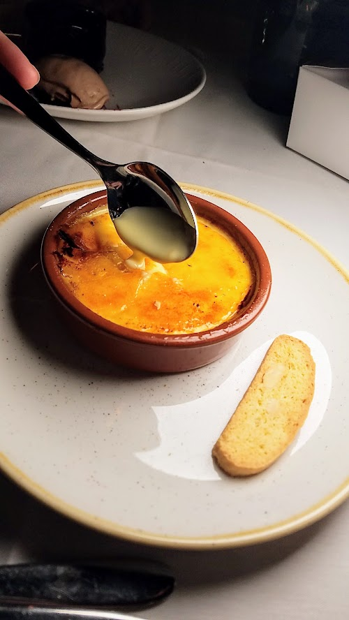 Can Font dessert of Crema Catalana with Bruleed cinnamon and lemon custard and orange and brown butter biscotti
