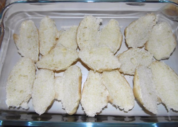 In a 9x13 casserole arrange the sliced croissants with the cut side up covering...