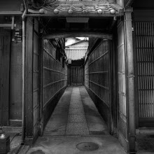 Photo: Higashiyama Alley  I found this little alley way - it's one of many in the Higashiyama district of Kyoto. There was almost no one on this street at the time, because a major parade was going on related to Gion Matsuri.  This is my first attempt at a square format photo ... let me know what you think!