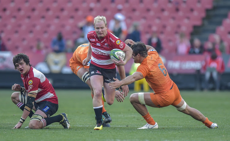Tomas Lavanini of the Jaguares (L) tackles Ross Cronje of the Emirates Lions with Pablo Matera(c) of the Jaguares(R) during the 2018 Super Rugby game between the Emirates Lions and the Jaguares at Emirates Airline Park Stadium, Johannesburg on 21 July 2018.