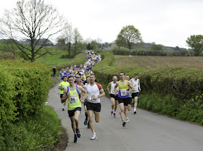 Photo: Winner of the 2015 Pensford 10k race Chris McMillan from Weston Athletic Club (no 86) at the start of the race