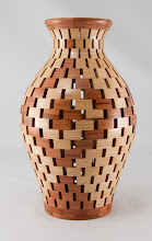 "Photo: Mike Twenty 7"" x 10 3/4"" open segmented vase [bubinga, hickory]"