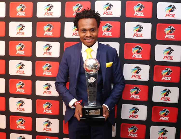 South Africa's Footballer of the Year winner Percy Tau pose for photographs with his trophy at the PSL Awards ceremony in Sandton on May 29 2018. The Mamelodi Sundowns star walked away with three awards.