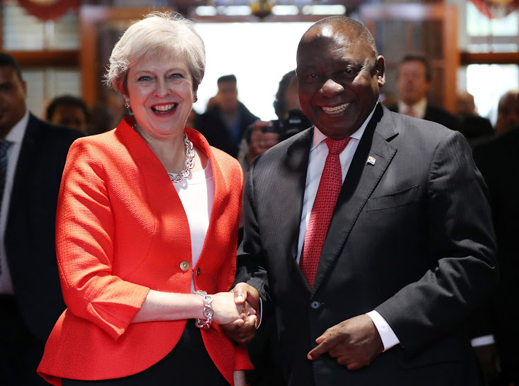 Britain's Prime Minister Theresa May is greeted by South African President Cyril Ramaphosa in Cape Town, South Africa, August 28, 2018.
