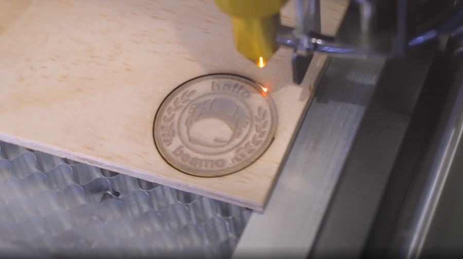 The CO2 laser cutting through corrugated cardboard with ease.