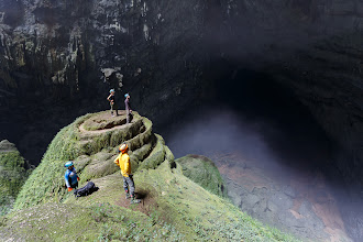 Photo: *Doline #1, Hang Son Doong*  A few members of our party standing on a travertine formation inside the first collapsed roof section of Son Doong Cave.  I'm really pleased to say that one of my previous photos I posted from Son Doong has been highlighted this week in the National Geographic Traveler Photo Contest. You can view (and vote!) for it here, no login required: http://travel.nationalgeographic.com/travel/traveler-magazine/photo-contest/2014/entries/rate/sense-of-place-week-11/#/262362 Please take the time to look at and vote for the other entries too, there really are some fantastic submissions.