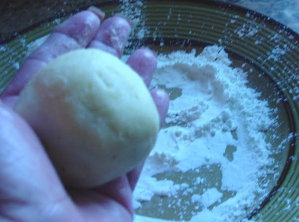 Using the cornstarch, put some on your hand so that the dough does not...