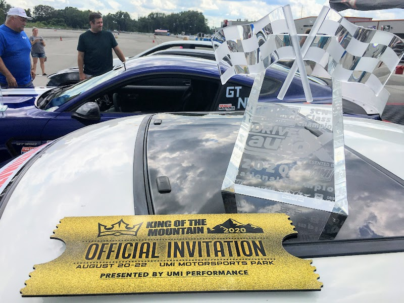 National Championship trophy and golden ticket on top of a car