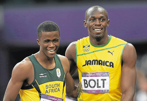 Anaso Jobodwana with Usain Bolt after the 200m final. File photo