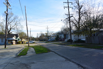 Photo: 21Feb14MostlyDelphine. General view of Delphine Street. The west side, at right, wholly restored; the left side in progress. This was not flooded like New Orleans in 2005, nor did it suffer much worse than the Zadok-sponsored Garden District (just across Government Street). It may be possible that problems with drugs were destructive (they were so even in the zone-protected tracts across Government Street, though you'd never guess it now). If this neighborhood just two or three blocks away to the north continues to be so well renovated, it will render great good to the whole mid-city.