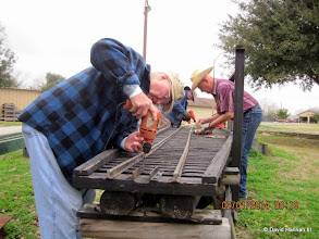 Photo: Bill Howe removing screws, while Art Morris (right) and Rick White (back left) do the same.   2014-0201  DH3