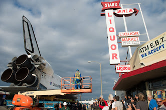 Photo: Spectators are seen photographing space shuttle Endeavour as it passes by on its way to its new home at the California Science Center, Friday, Oct. 12, 2012, in Inglewood.  Endeavour, built as a replacement for space shuttle Challenger, completed 25 missions, spent 299 days in orbit, and orbited Earth 4,671 times while traveling 122,883,151 miles. Beginning Oct. 30, the shuttle will be on display in the CSC's Samuel Oschin Space Shuttle Endeavour Display Pavilion, embarking on its new mission to commemorate past achievements in space and educate and inspire future generations of explorers. Photo Credit: (NASA/Carla Cioffi)