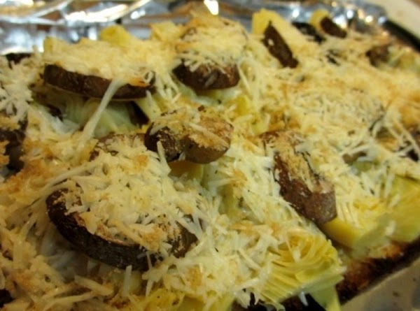 Preheat oven to 375 degrees F. Place artichoke pieces fan-side up on the toasted...