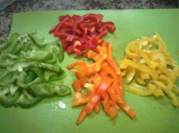 Slice the peppers in rings and then cut in half.