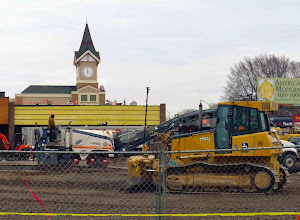 Photo: Three levels of workers--the grader, the guy chewing up the remaining parking lot, the asbestos guys on the roof.