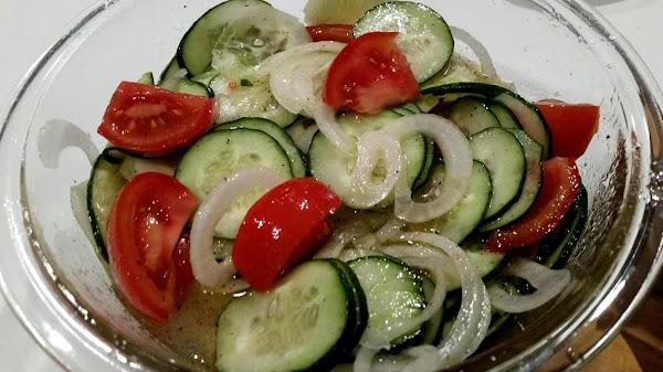 In a large bowl, whisk together the vinegar, oil, sugar, salt & pepper.  Toss veggies...