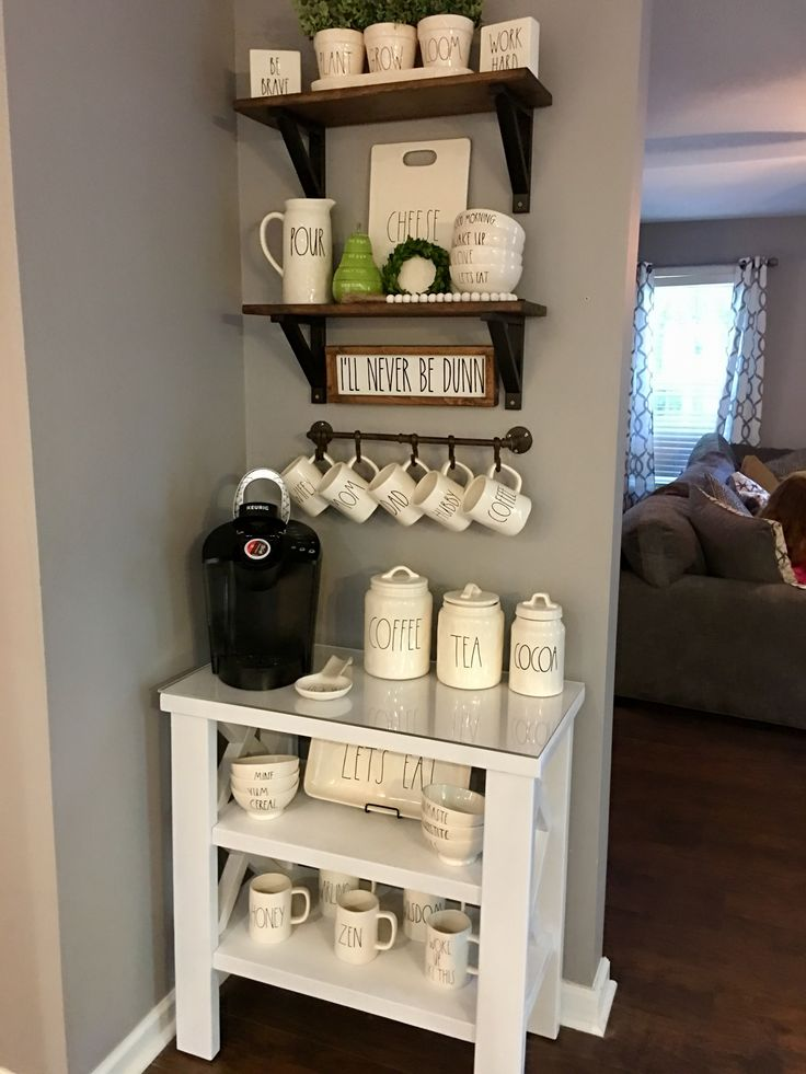 small coffee station against a wall with matching mugs, mini keurig and open shelving