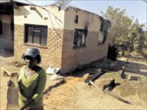 DESTRUCTION: Kgomotso Setagane of Motupa village in Limpopo helps her family erect a shack after their home was destroyed by a mysterious fire. PIC: Alex Matlala. 07/09/2009. © Sowetan.