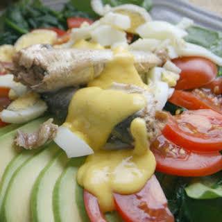 Spinach and Sardine Breakfast Salad with Hollandaise Sauce.