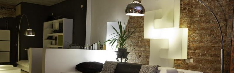 modern lamps in a room above a couch