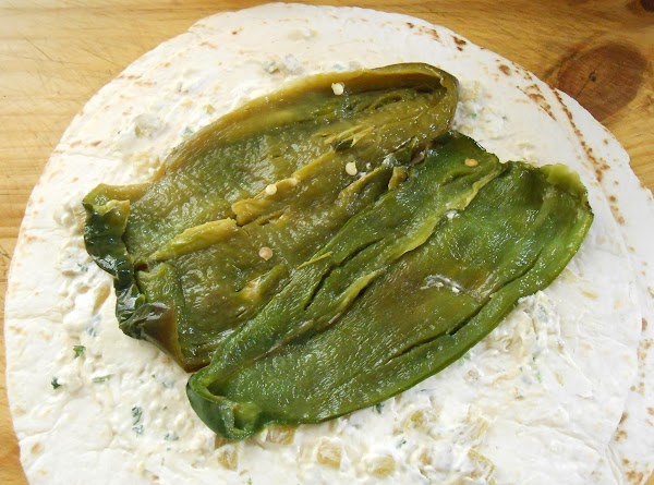Lay 2 poblanos halves out side by side.  Spoon in about 1/2 c...