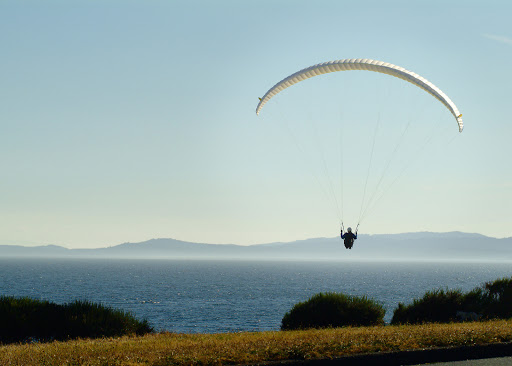 Victoria-BC-paragliding.jpg - A paraglider soars across the bay near Victoria, British Columbia.